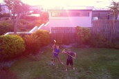 This picture cracks me up - silly boys having fun in the back yard with croquet.