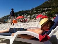 Sam soaking in the sun at Clifton Beach.