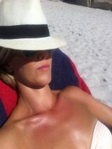 Soaking up the sun on Clifton Beach.