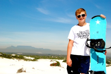 Love this! Matt sandboarding with Table Mountain in the background.
